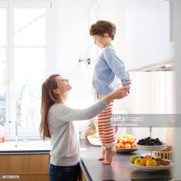 A mom and her son in the kitchen