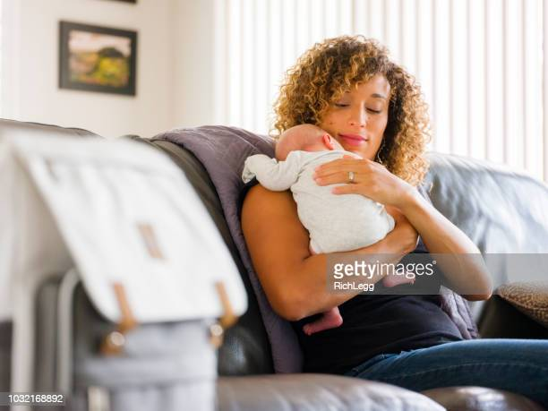 mom and newborn baby in a home - diaper bag stock pictures, royalty-free photos & images