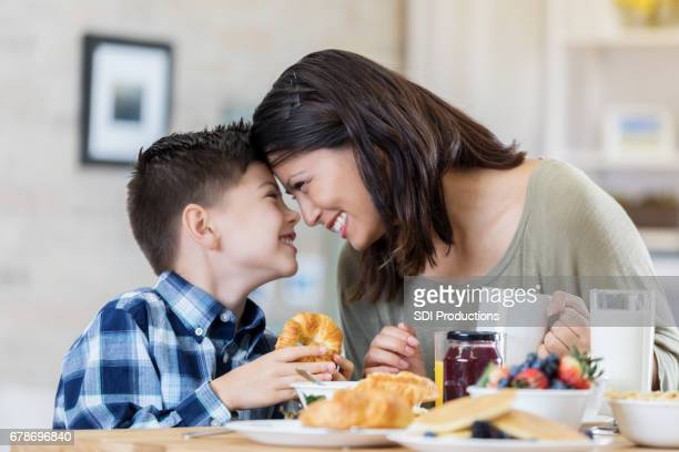 Mom and son enjoy breakfast together