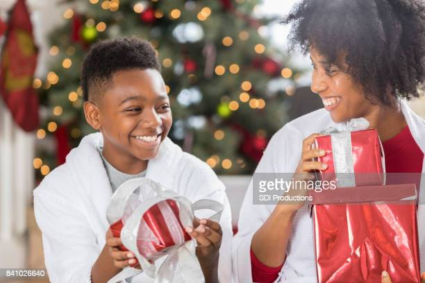 Mom and son exchange presents on Christmas morning