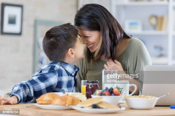 Mom and son share a healthy breakfast
