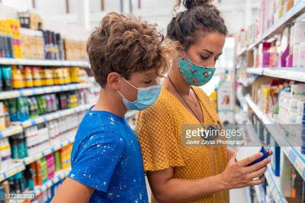 mom and son shopping at supermarket - spain stock pictures, royalty-free photos & images