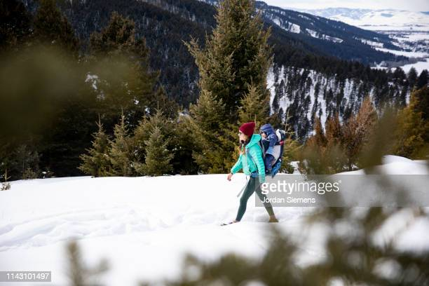 mom and son winter hiking. - bozeman stock pictures, royalty-free photos & images