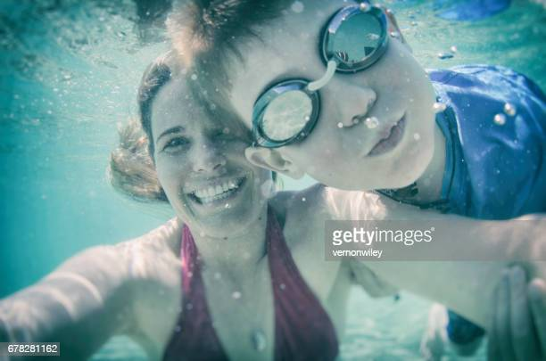 Mom and son with a goofy underwater selfie