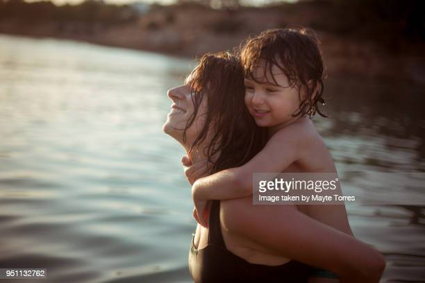 mom and toddler enjoying in the beach - hot spanish women stock pictures, royalty-free photos & images