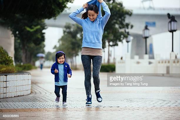 Mom and toddler girl walking