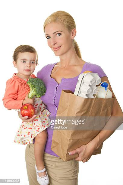 mom and toddler grocery shopping