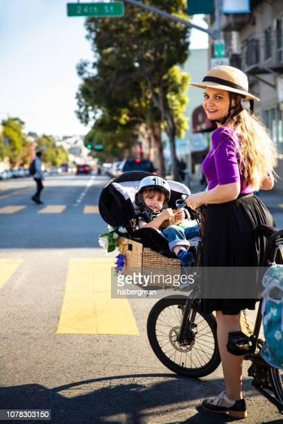 Mom and Toddler Riding Cargo Bike Through San Francisco
