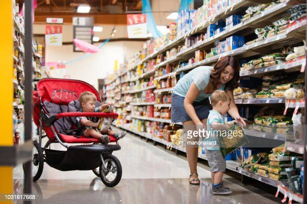 Mom at the grocery store with his son with Down Syndrome