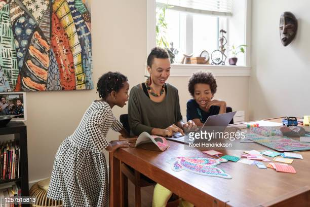 mom attempting to homeschool her kids - homeschool stock pictures, royalty-free photos & images