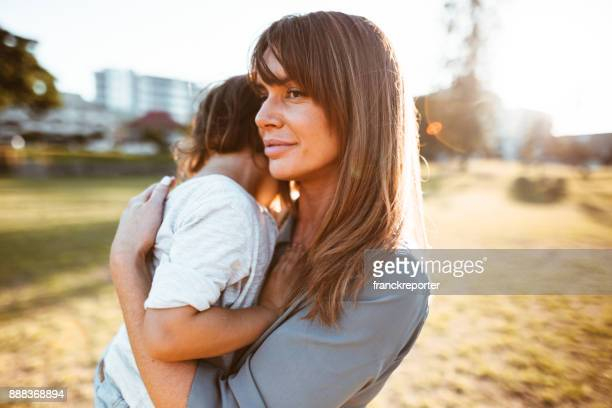 mom carrying a little kid - sad mom stock pictures, royalty-free photos & images