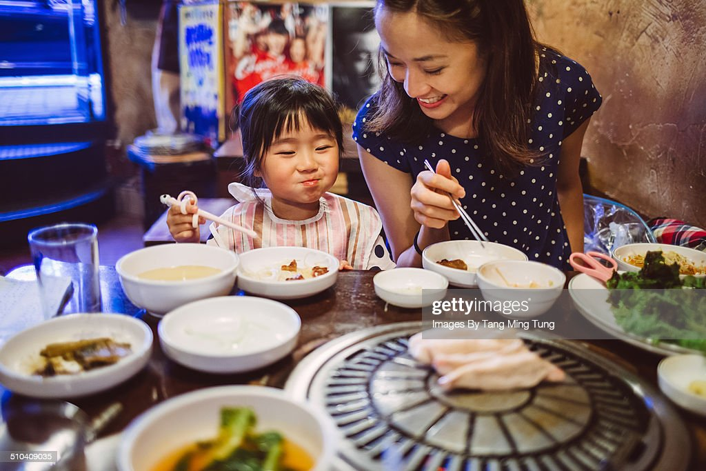 Mom & child having meal in Korean restaurant : Stock Photo