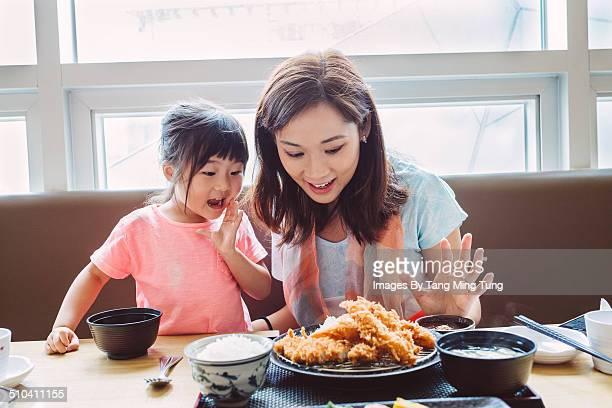 Mom & child looking at tempura set joyfully