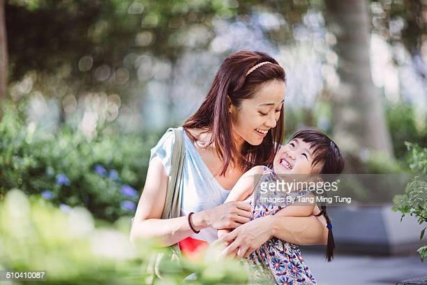 Mom & child playing joyfully in park
