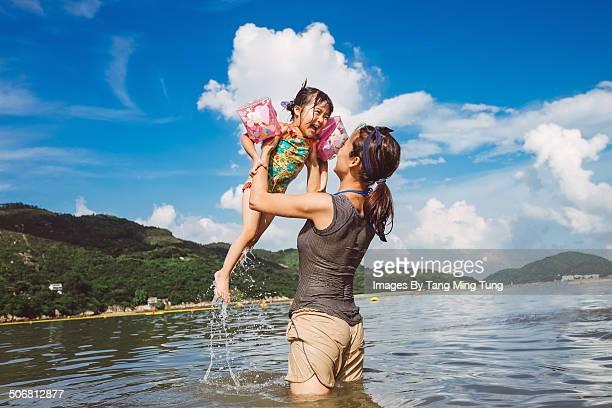Mom & child playing joyfully in the sea