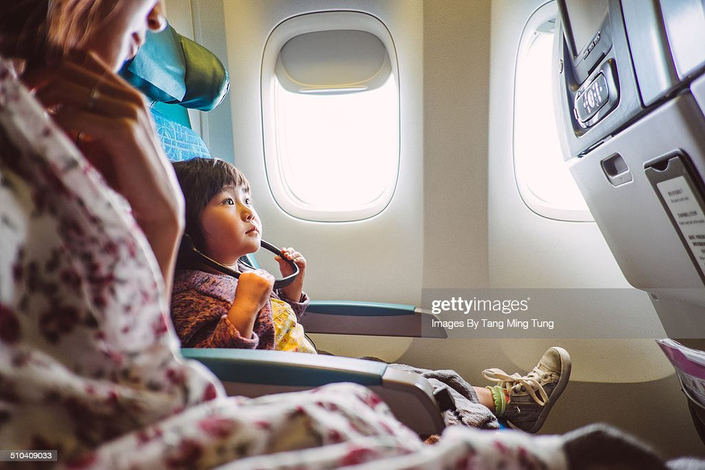 Mom & child riding on the airplane : Stock Photo