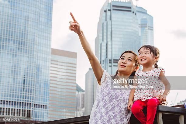 Mom & child talking joyfully in commercial area