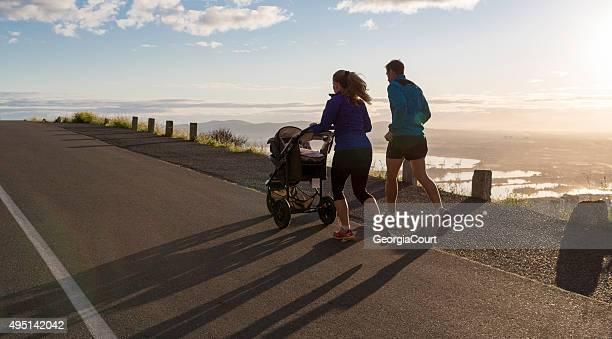 Mom Dad and Baby Sunrise Running