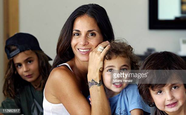 Mom Danielle Goodman shows her multiple butterfly tattoo that represents her three sons Ethan 8 Matt 3 and Eli 6