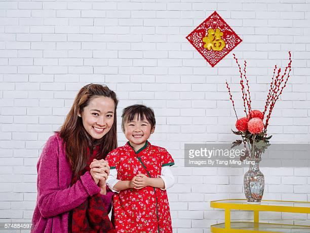 Mom & daughter celebrating CNY joyfully at home