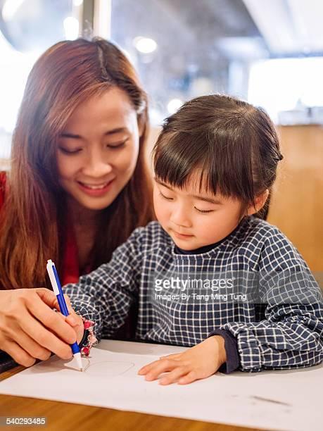 Mom & daughter drawing joyfully