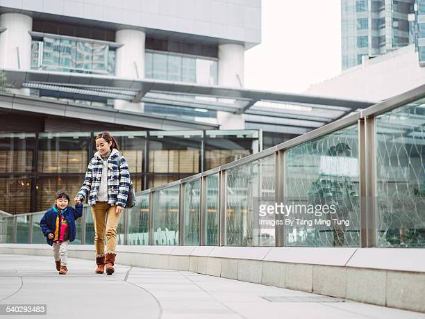Mom & daughter strolling in rooftop garden