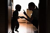 Mom disciplining her child.