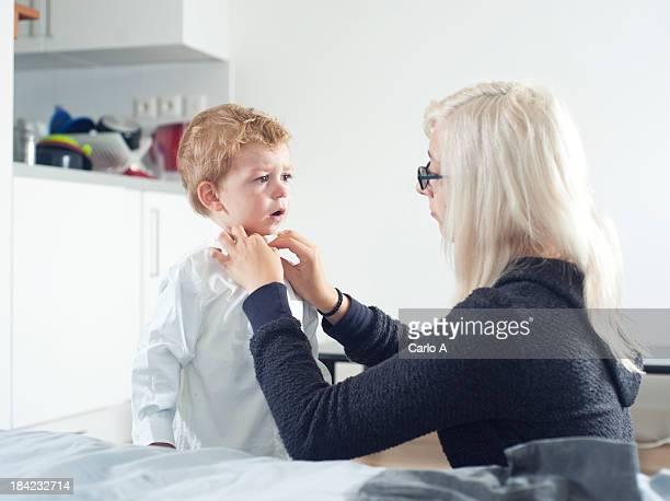 Mom dressing baby
