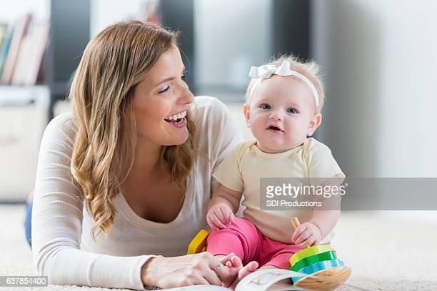 Mom enjoys playing with baby girl