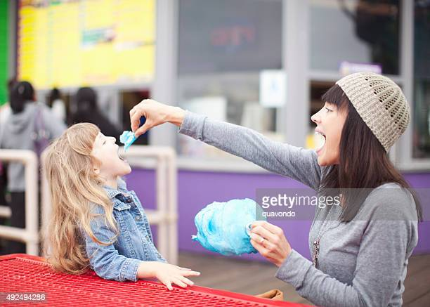 Mom Feeding Daughter Cotton Candy