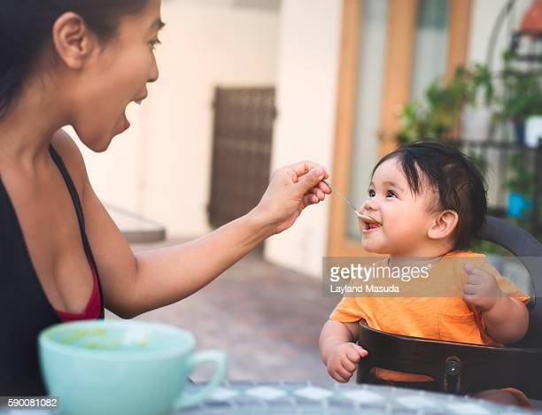 Mom Feeds Baby Solid Food