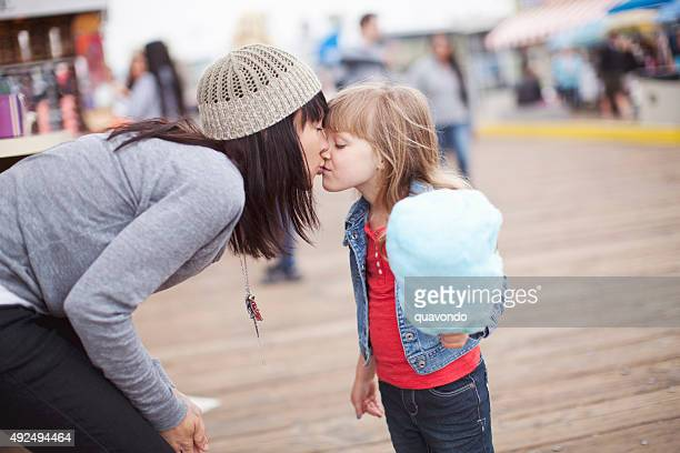 Mom Gives Daughter a Kiss