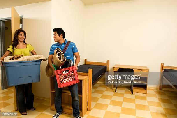 Mom helping son move into college dorm room