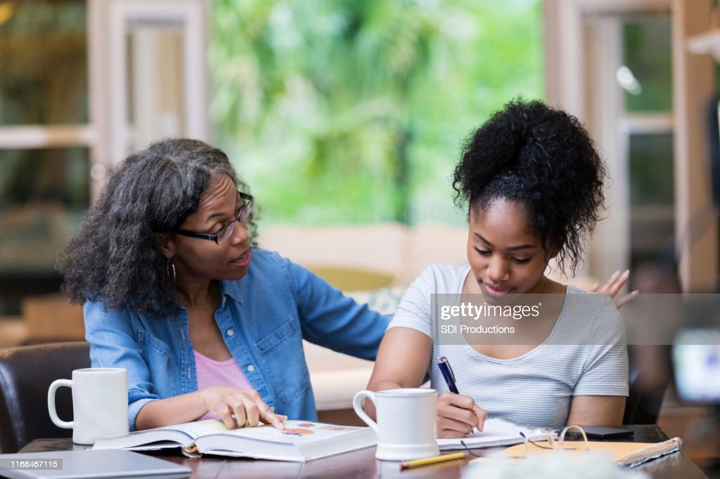 Mom helps daughter study for biology test : Stock Photo