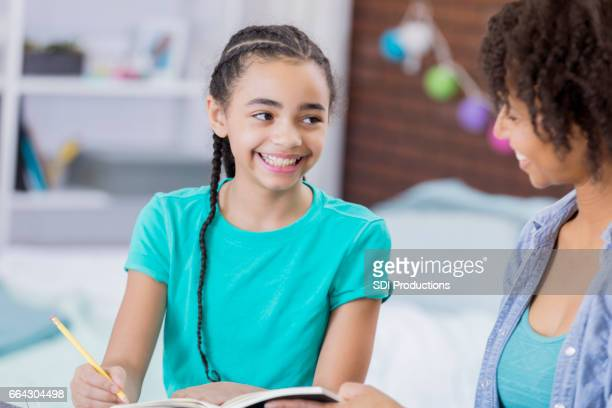 Mom helps tween girl with homework