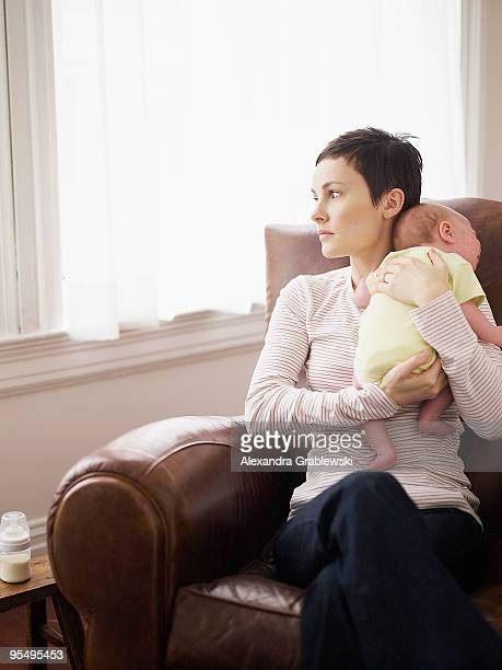 mom holding baby - postpartum depression stock pictures, royalty-free photos & images