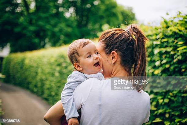 Mom holding child in park