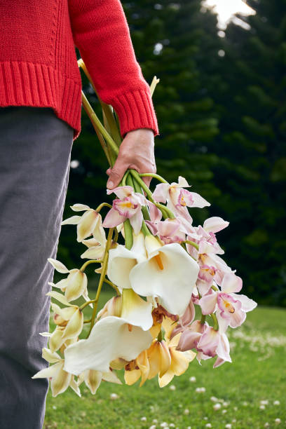 Mom holding Mother's day flowers in Springtime
