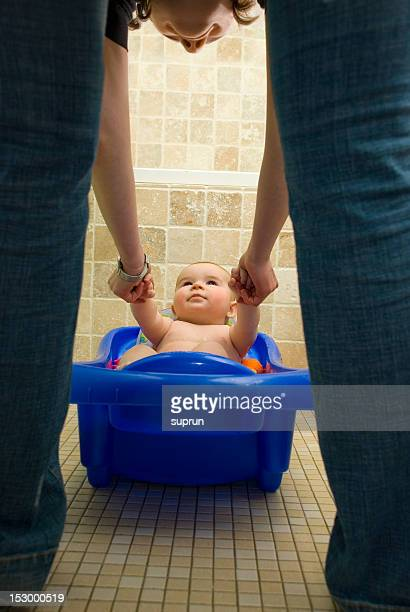 Mom is Playing with Her Son in a Bathtub