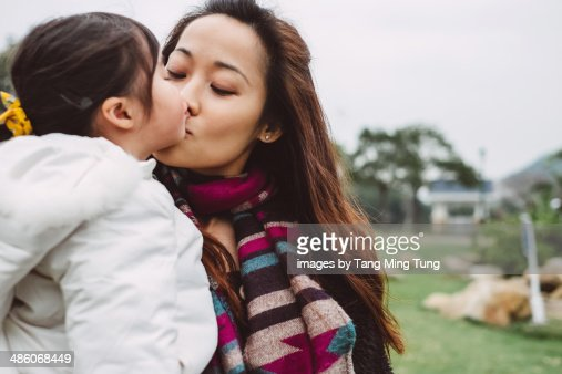 Mom Kissing Little Girl Daughters Lips In Park Stock Photo  Getty Images-2025