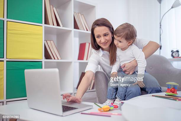 mom let me to watch a favorite cartoon - little girls webcam stock photos and pictures