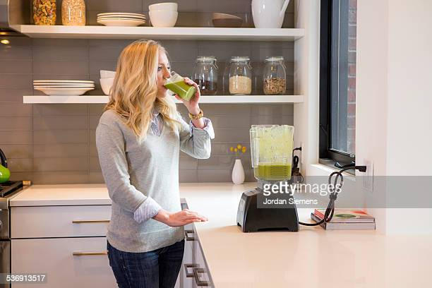 A mom making a healthy smoothie.