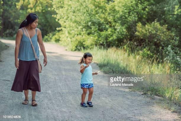 mom not happy with toddler stick play - girls with short skirts - fotografias e filmes do acervo