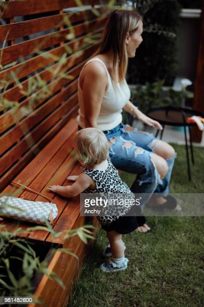 Mom playing with her daughter in the backyard