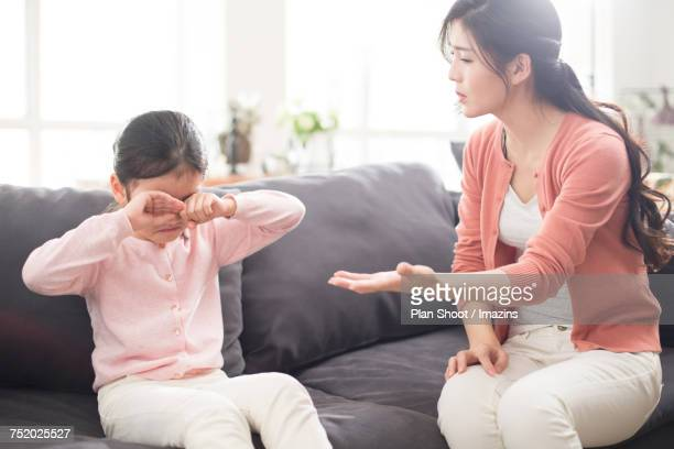 mom rebuking her daughter - mother scolding stock pictures, royalty-free photos & images