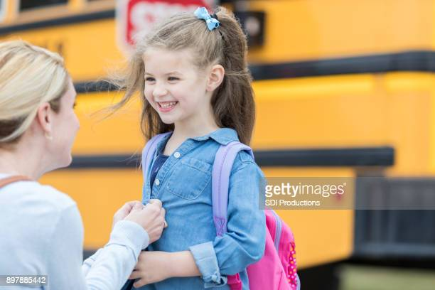 mom sends her daughter off to school - clothes on clothes off photos stock pictures, royalty-free photos & images