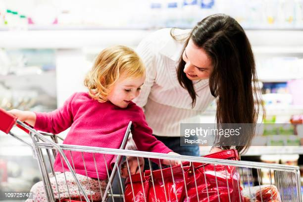 Mom shopping with pretty daughter