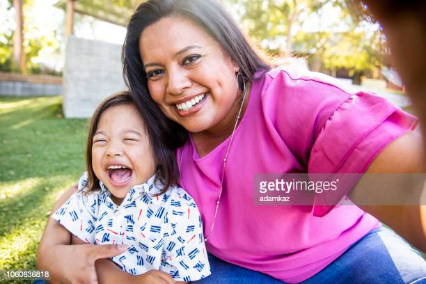 mom taking a selfie with son - mexican ethnicity stock pictures, royalty-free photos & images