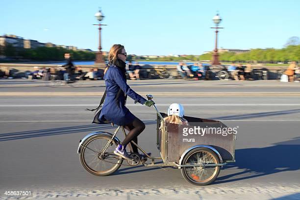 Mom taking her child in Christiania bike