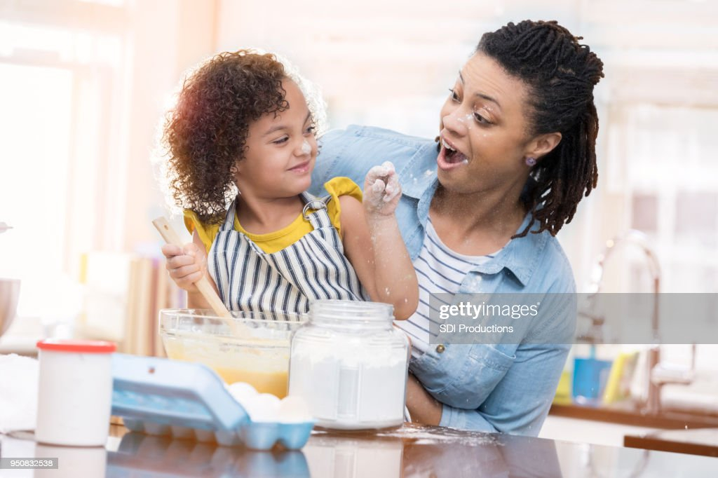 Mom Teaches Young Daughter To Bake Stock Photo